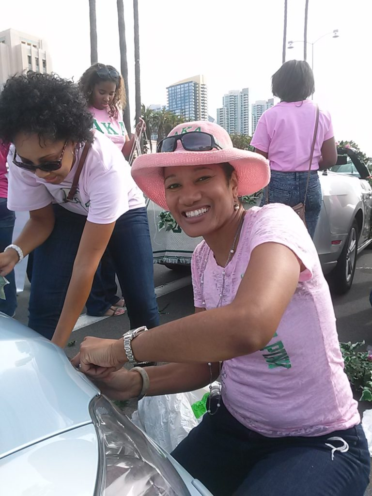 Lan Jefferson of Alpha Kappa Alpha Sorority helps get a parade float ready to go